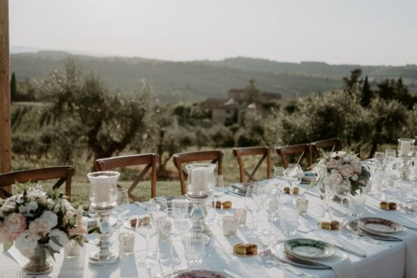 Country chic wedding dinner table at agriturismo in Chianti Tuscany
