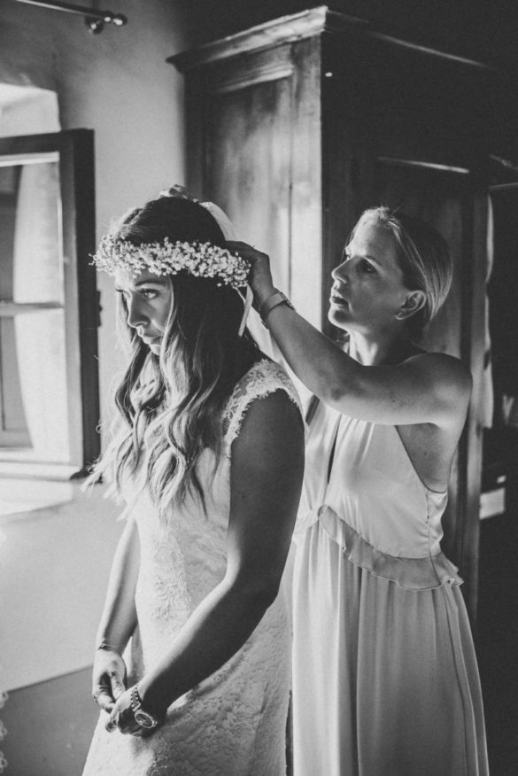 Checking the brides hair corsage