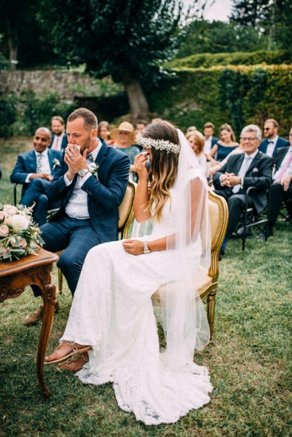 Emotional wedding couple during symbolic ceremony.