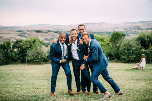 Groom and best men pose fore Romy Dermout