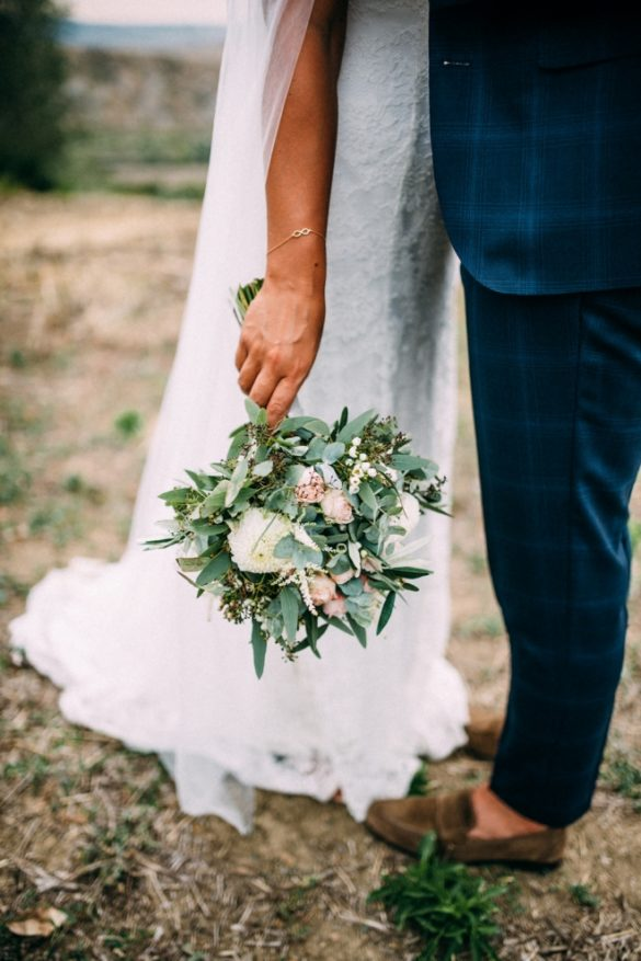 Bohemian spouses with blush wedding bouquet