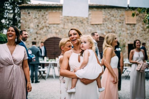 Wedding guests having a good time before dinner, blush pastel dresses