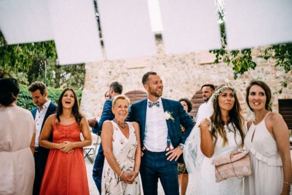 Wedding guests and spouses during bohemian themed party