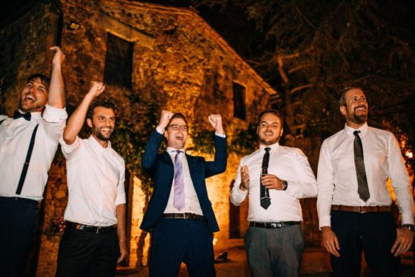 Friends of the groom ready to party at Tuscan borgo