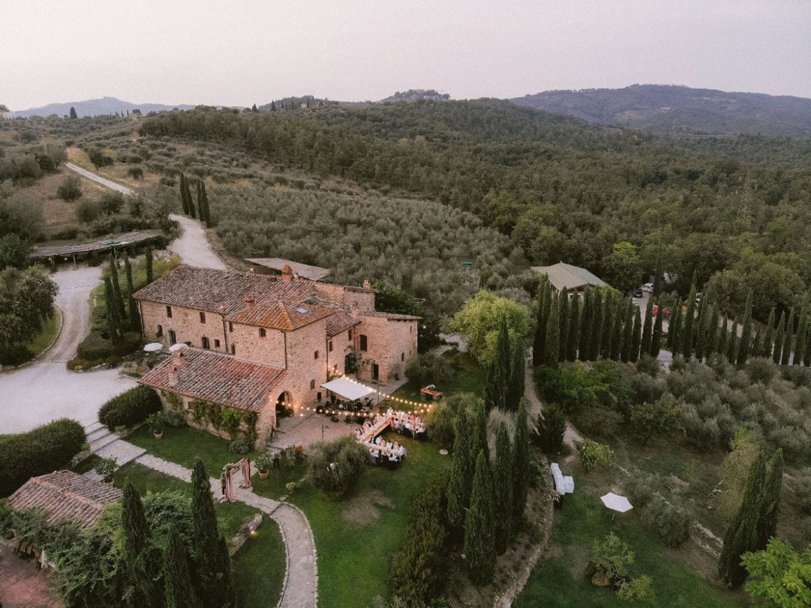Drone image of splendid outdoor wedding dinner in Tuscany