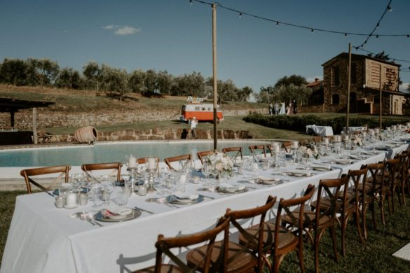Stylish country chic wedding dinner table in Tuscan countryside