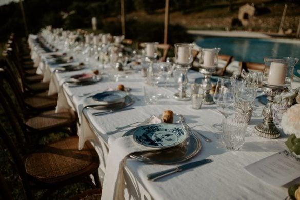 Chic rustic wedding dinner table pool side Chianti Tuscany