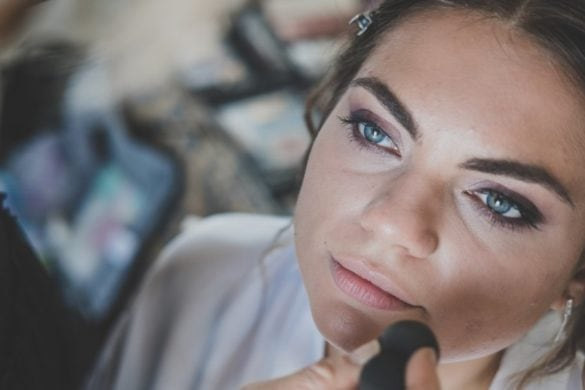 Detail of make up while bride is getting ready for her marriage in Tuscany.