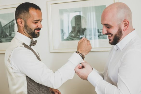 Groom is getting ready for his religious marriage in Tuscany with help of best man..