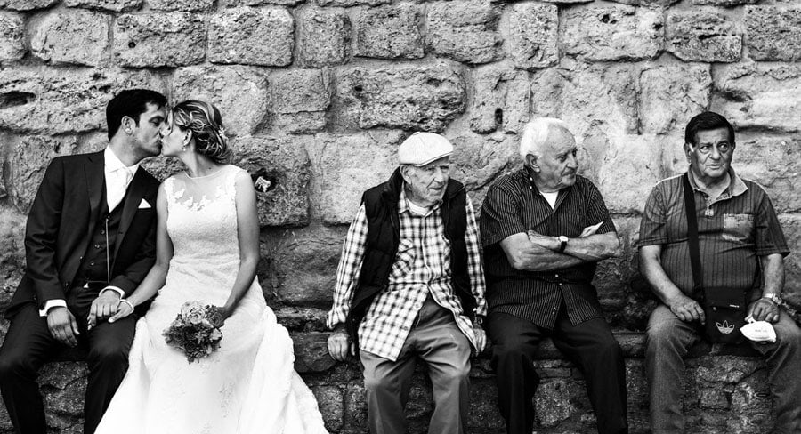 Dutch wedding couple with old italian men, Volterra Italy