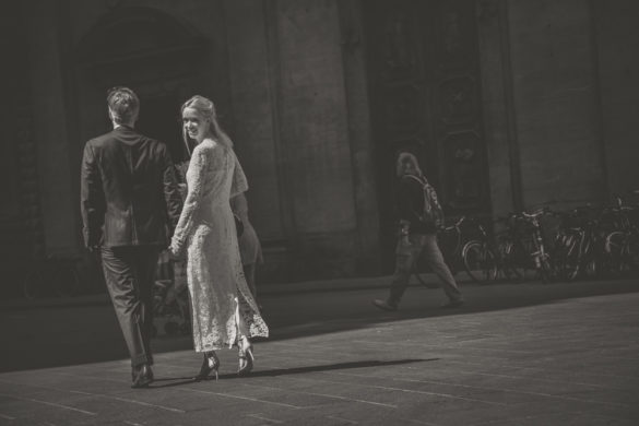 Bride and groom walking in Florence historic centre