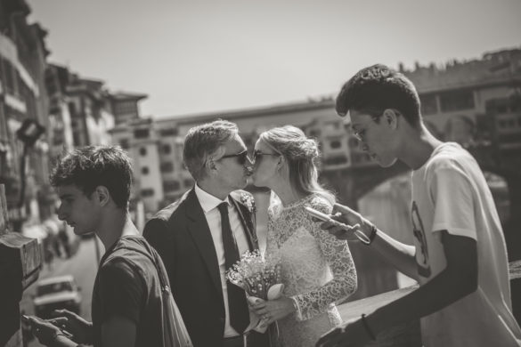 Wedding couple kissing with Ponte Vecchio in the back, Florence