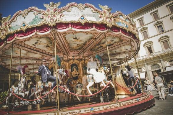 Fun photo of bridal couple in carousel Florence