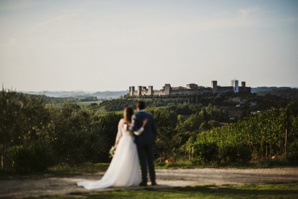 Wedding couple enjoys panoramic view from wedding location on stunning countryside