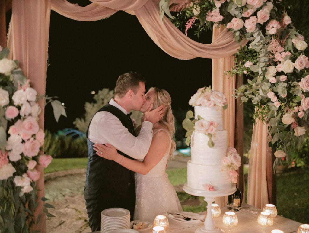 Romantic tier wedding cake with blush colored flowers